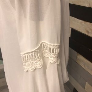 White blouse with bell sleeves